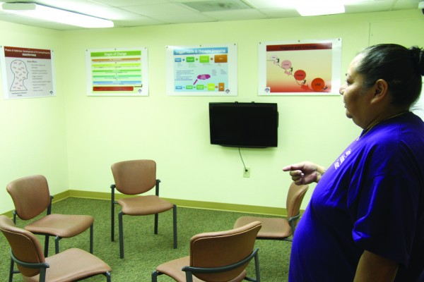 Velva Powell, Unity Healing Center social services assistant, shows a group room during the open house.