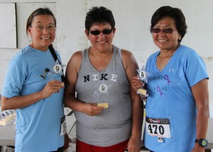 The winners in the Womens 51 and over division are shown (left-right):  Gerri Grady, third place; Carolina Oocumma, first place; and Elnora Thompson, second place.