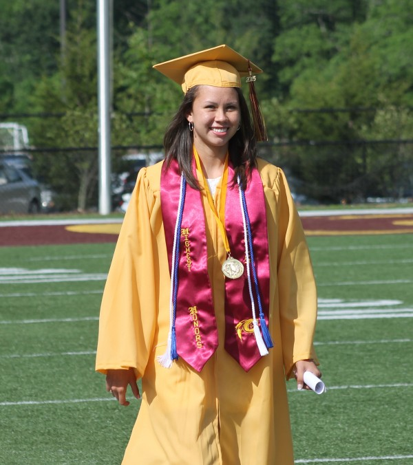 """Kendall Toineeta, CHS Class of 2015 valedictorian, enters Ray Kinsland Stadium during the graduation processional """"Pomp and Circumstance"""" on Saturday, May 30.  (SCOTT MCKIE B.P./One Feather photos)"""