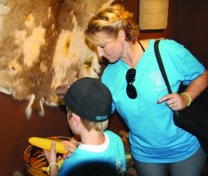 Rebekha Johnson (right) and Justin Barton, of Camp Amigo for burn victims, visit the Museum of the Cherokee Indian on Thursday, July 25.  (SCOTT MCKIE B.P./One Feather photos)