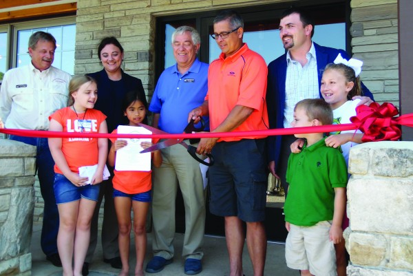 Principal Chief Michell Hicks cuts the ribbon to officially open The Fly Fishing Museum of the Southern Appalachians, located in Cherokee, on Saturday, June 6.  (CARSON LAMBERT/One Feather intern)