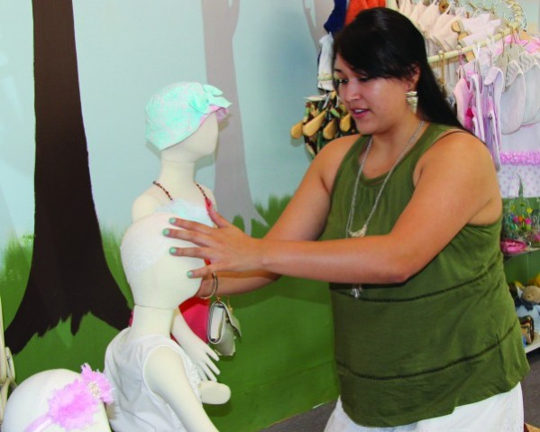 Elle Bradley works in her new boutique in downtown Cherokee called The Little People.  (AMBLE SMOKER/One Feather)
