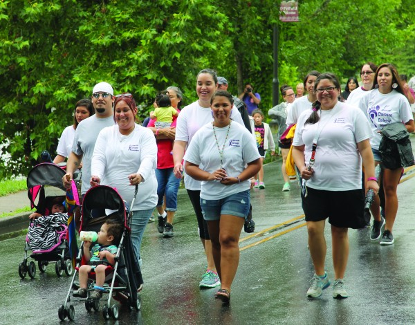 Miss Cherokee Taylor Wilnoty leads the 1st Annual Cherokee Epilepsy Walk, an event she organized, on Saturday, June 27.  (SCOTT MCKIE B.P./One Feather)