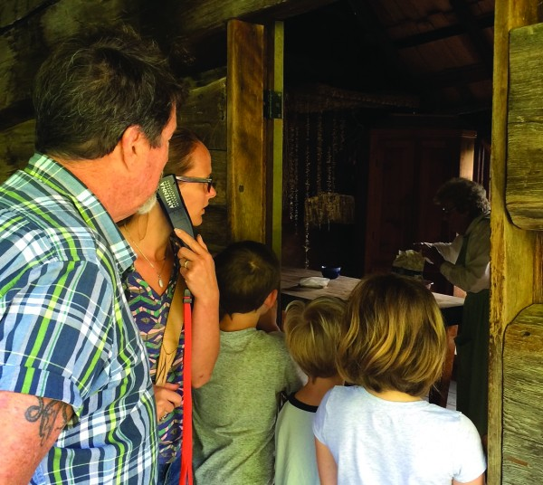 The Nance family of Seattle, Wash. was among the first to experience a new audio tour of the Mountain Farm Museum at Oconaluftee Visitor Center in Great Smoky Mountains National Park earlier this month.   (GSMA photo)