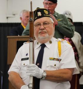 EBCI tribal member Sam Lambert, a member of the Post 143 color guard and a Vietnam Veteran, helped post the colors at Saturday's event.