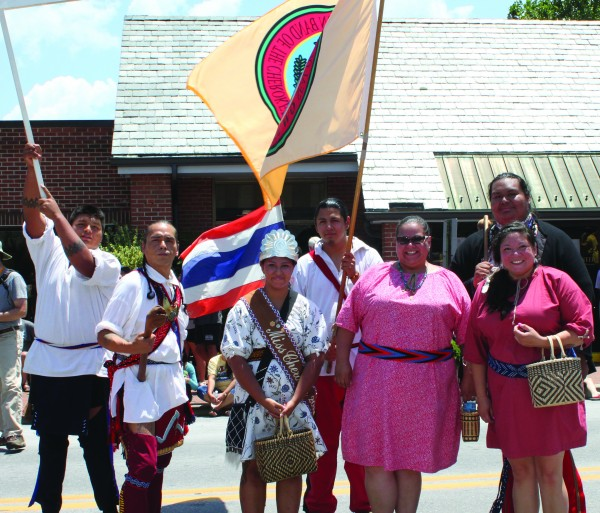 The Tsalagi Touring Group is shown (left-right) at the Folkmoot Parade in Waynesville - Byron Locust, James Wolfe, Miss Cherokee Taylor Wilnoty, Leslie Lossiah, Jarret Wildcatt and Program Director Lisa Wilnoty.  (Photo courtesy of Taylor Wilnoty)