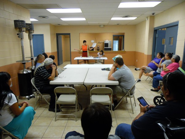 Frieda Huskey (front in orange), EBCI Events and Fairgrounds supervisor, prepares to draw for the 2015 Cherokee Indian Fair Food Booths on Monday, Aug. 24.  (ROBERT JUMPER/One Feather)