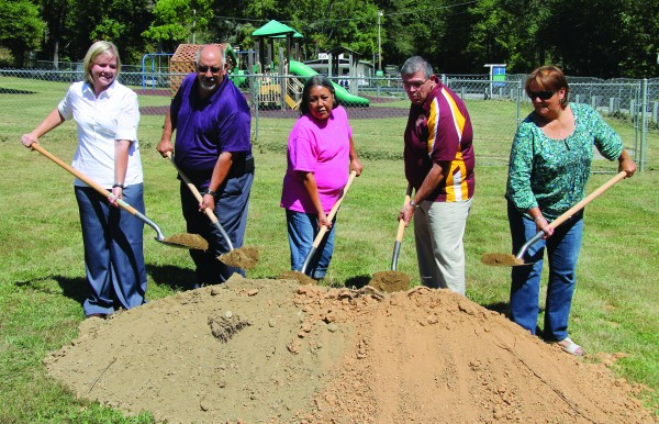 Ground was broken on the new Big Cove Day Care Center on Thursday, Sept. 17.  Shown (left-right) are Natalie Cooper-Case, EBCI Head Start administrative director; Big Cove Rep. Perry Shell; Big Cove Community member Katie Johnson; Big Cove Rep.-elect Richard French; and Big Cove Rep. Teresa McCoy.   (SCOTT MCKIE B.P./One Feather photos)