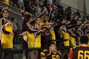 Braves varsity cheerleaders and fans scream after Jason McMillan scored the winning touchdown on Friday night.  (SCOTT MCKIE B.P./One Feather)