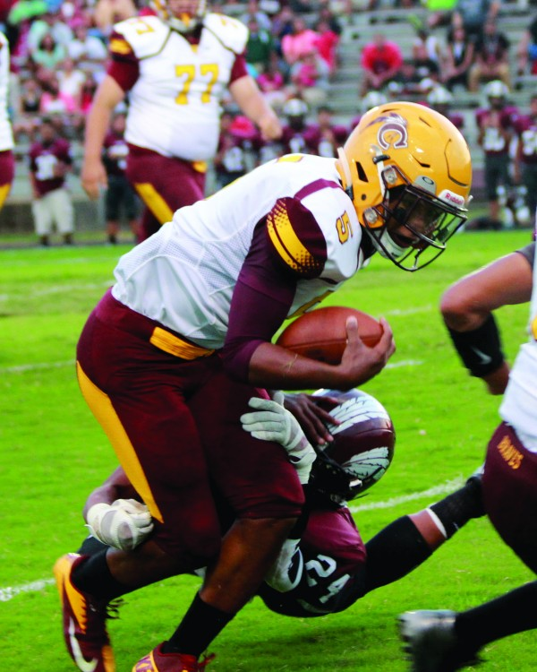 Isaiah Evans (#5), Braves running back, tries to break a tackle in the first half of the Battle of the Nations game at Choctaw Central.  On the game, he had 63 yards on 10 carries and one touchdown.  (AMBLE SMOKER/One Feather)