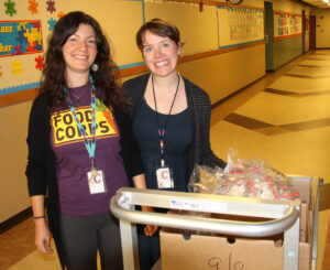 Katie Rainwater, Food Corps, and Janette Broda, Cherokee Elementary School nutrition director, deliver vegetable snacks to students on Thursday, Sept. 17.