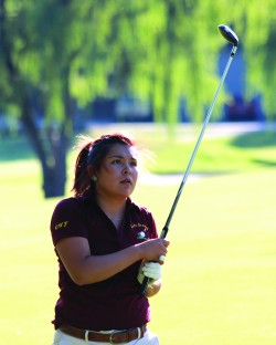 Cherokee's Bree Stamper watches a shot during a five-school match at The Golf Club at Mill Creek in Franklin on Tuesday, Sept. 15.  She shot a 53 as the Lady Braves took second overall with a team score of 159.  (AMBLE SMOKER/One Feather)