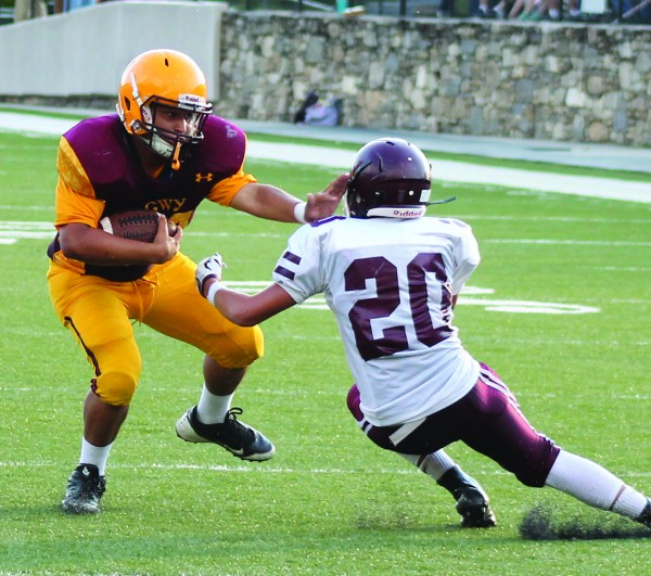 Cherokee's Xander Brady (#42) gives a stiff arm to Swain's Hunter Burrell during the first half of Thursday's game.