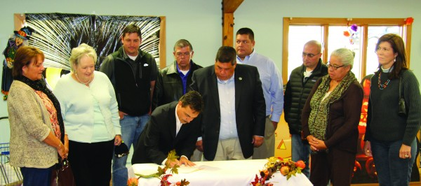 Principal Chief Patrick Lambert signed legislation at Tsali Manor on Wednesday, Oct. 21 that will double the Christmas Checks for EBCI tribal seniors and disabled persons.  He was joined by members of Tribal Council including (left-right) – Big Cove Rep. Teresa McCoy, Painttown Rep. Tommye Saunooke, Birdtown Rep. Albert Rose, Big Cove Rep. Richard French, Chairman Bill Taylor, Birdtown Rep. Travis Smith, Wolfetown Rep. Bo Crowe, Painttown Rep. Marie Junaluska and Yellowhill Rep. Anita Lossiah.