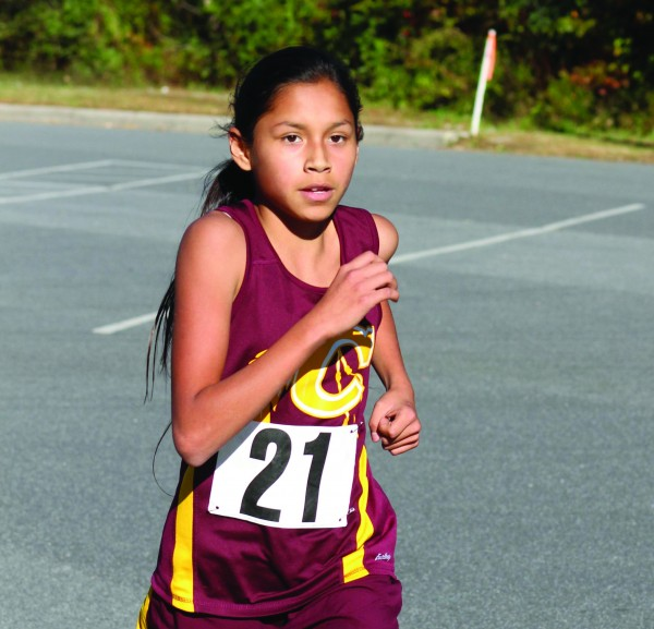 Lady Braves' Maria Reyes runs on her way to a first place finish in the Smoky Mountain Conference middle school cross country championship at Cherokee on Wednesday, Oct. 21.  She helped lead the CMS Lady Braves to a team championship, the first in school history, with a team score of 38 points.  (SCOTT MCKIE B.P./One Feather photos)