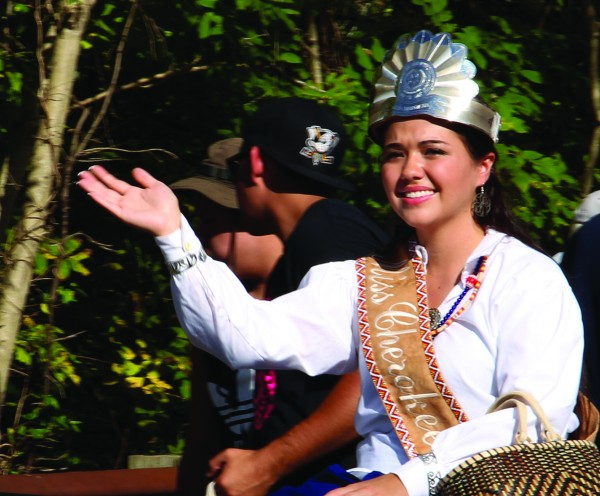 Amorie Gunter, named Miss Cherokee at the Oct. 3 pageant, waves to the crowd during the Cherokee Indian Fair Parade on Oct. 6.  Prior to having her crown and title taken several days later due to a scoring mistake, she participated in several events throughout the week at the Fair as Miss Cherokee.