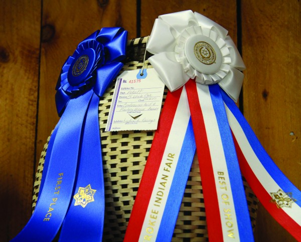 Lydia L. Goings won a first place ribbon and a Best of Show ribbon for her display of white oak baskets in the Qualla Arts & Crafts contests at this year's Cherokee Indian Fair. (SCOTT MCKIE B.P./One Feather photos)