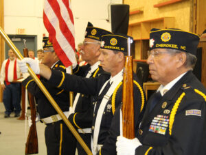 The Steve Youngdeer American Legion Post 143 Color Guard posts the colors to open the program.