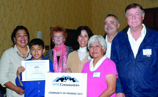 Big Y Community is shown being presented a Community of Promise Award (left-right) Trudy Crowe, Gage Welch, presenter Janna Hyatt with Harrah's Cherokee, Donna Lambert, Reva Brown, Dave Lambert and Donald Brown.