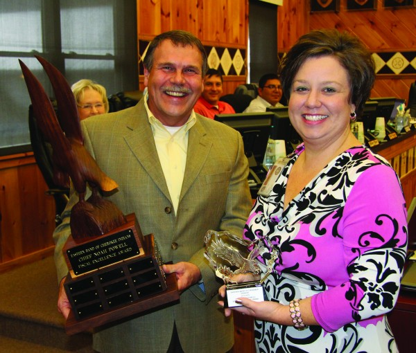Mark Bumgarner (left), EBCI Audit Committee vice chairman, presents the Chief Noah Powell Fiscal Excellence Award to Melanie Ashe, Cherokee Home Health program manager, who accepted the award on behalf of the entire program.  (SCOTT MCKIE B.P./One Feather)