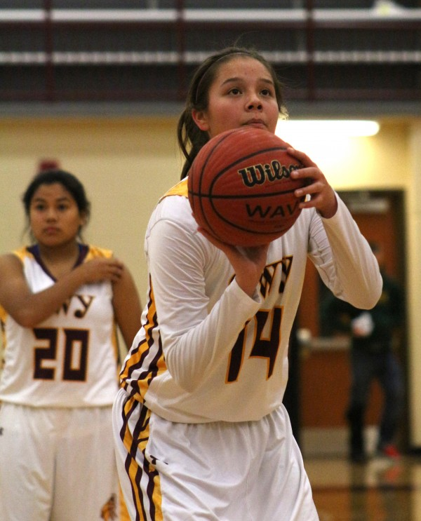 Cherokee's Shelby Wolfe lines up for a free throw.  She led the Lady Braves with 18 points on the night.