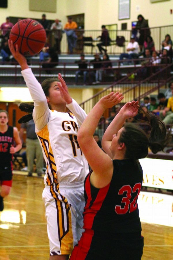 Cherokee's Shelby Wolfe (#14) shoots over Andrews' Haley West (#32) during a home game on Tuesday, Dec. 8.  Wolfe finished the game with 21 points.  (SCOTT MCKIE B.P./One Feather photos)