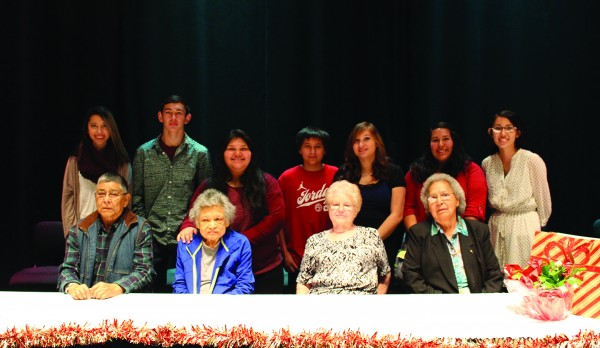 """EBCI tribal elders were recently honored by Cherokee Central Schools including (front row, left-right) Marvin """"Skilly"""" French, Anna Laura Jumper, Margaret Green McCall, Katherine Norlen Panther. Students are shown in the back row including: Bree Zollinger, Anthony Toineeta, Annleeta Montoya, Khylan Pheasant, Shiah Pheasant, Lou Montelongo and Kendra Panther. (CCS photos)"""