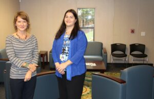 Lara Conner, Recovery Center lead, and Kristi Case, MPA, Recovery Services manager, are shown in the new Analenisgi Recovery Center located at the old Mountain Federal Credit Union site.  (SCOTT MCKIE B.P./One Feather photos)