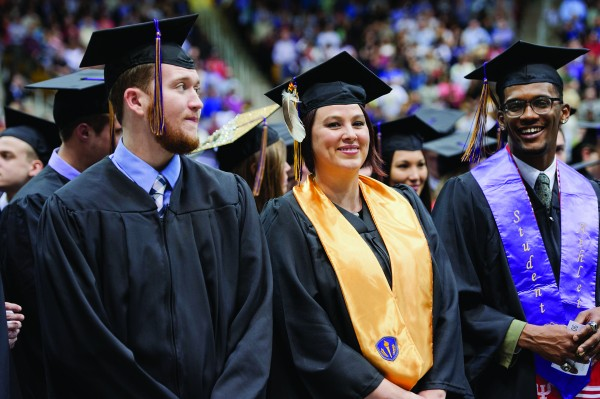 Sabrina Sue Arch (center), an EBCI tribal member, was among graduating students taking part in WCU's fall commencement on Saturday, Dec. 12. She has been working toward her bachelor's degree in entrepreneurship at the university.  (WCU photos)