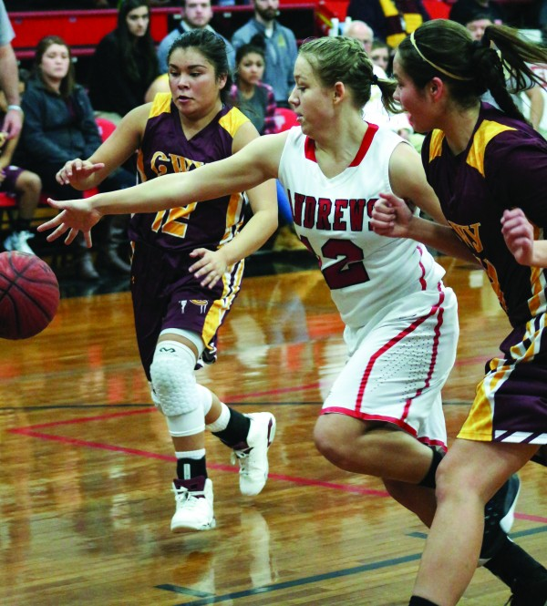 Cherokee's Bree Stamper (#12) and Shelby Wolfe (#14) chase a loose ball lost by Andrews' Jacqueline West (#12) in a game at Andrews on Tuesday, Jan. 19. Stamper scored 15 and Wolfe added 13 to help lead the Lady Braves. (SCOTT MCKIE B.P./One Feather photos)