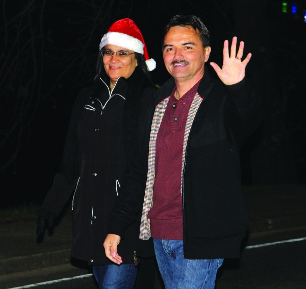 First Lady Cyndi Lambert and Principal Chief Patrick Lambert wave to the crowd during the annual Cherokee Christmas Parade held on Saturday, Dec. 5.  (SCOTT MCKIE B.P./One Feather)