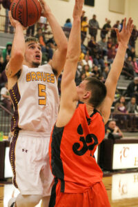 Cherokee's Tye Mintz (#5) goes up strong against Rosman's Deland Thomas (#32) in the second half of Friday's game.  Mintz finished the game with 20 points, 2 assists, 9 rebounds and 1 steal.