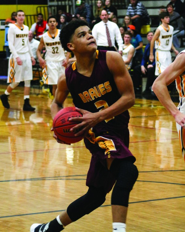 Justus Day, Braves sophomore forward, prepares for a layup in the first half of Friday's game at Murphy.  He led Cherokee with 26 points, 2 assists, 1 rebound and 3 steals. (SCOTT MCKIE B.P./One Feather photos)