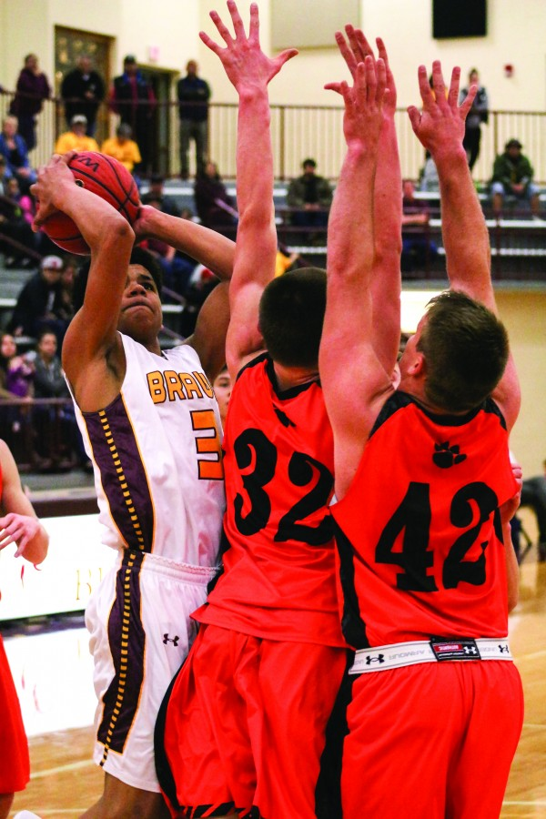 Cherokee's Justus Day (#3) shoots over two Rosman defenders including Deland Thomas (#32) and Tanner Green (#42) in the waning minutes of Friday's home game.  Day led Cherokee on the night with 24 points, 1 assist, 2 rebounds and 2 steals.  (SCOTT MCKIE B.P./One Feather photos)