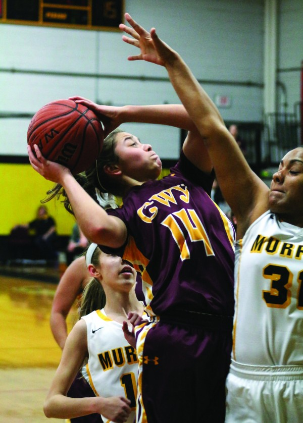 Cherokee's Shelby Wolfe (#14) goes for a shot around Murphy's Kiara Dalrymple during a game at Murphy on Friday, Jan. 29. Wolfe finished the game with 10 points. (SCOTT MCKIE B.P./One Feather photos)