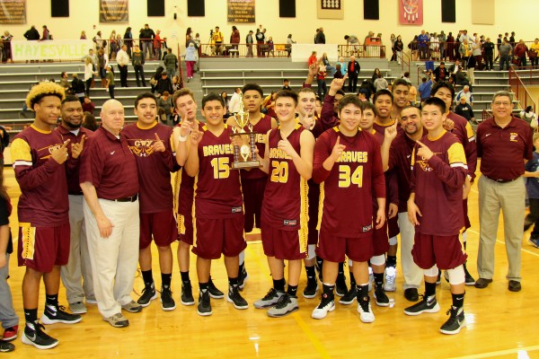 The Cherokee Braves won the Big Smoky Mountain Conference tournament title over Hayesville 102-96 on Friday, Feb. 19 in the Charles George Memorial Arena. (SCOTT MCKIE B.P./One Feather photos)
