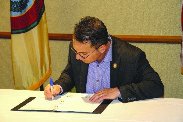 Vice Chief Rich Sneed signs a multi-agency Candidate Conservation Agreement on Tuesday, Feb. 23 to help save the sicklefin redhorse.  (SCOTT MCKIE B.P./One Feather)