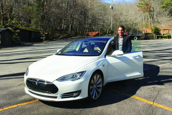 Vice Chief Rich Sneed is shown with the used 2013 Tesla Model S that he recently purchased. (ROBERT JUMPER/One Feather)
