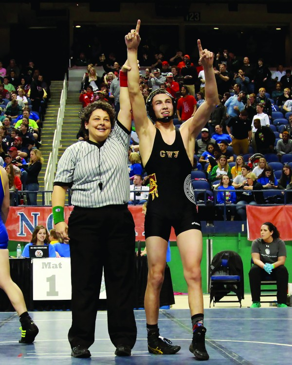 The referee raises Anthony Toineeta's hand for the victory immediately after he won the 1A state championship in the 145lb division over Princeton's Michael Daughtry on Saturday, Feb. 20. (AMBLE SMOKER/One Feather photos)