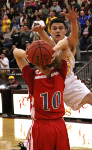 Cherokee's Holden Straughan (#20) plays tough defense against North Stanly's Weston Dennis (#10).