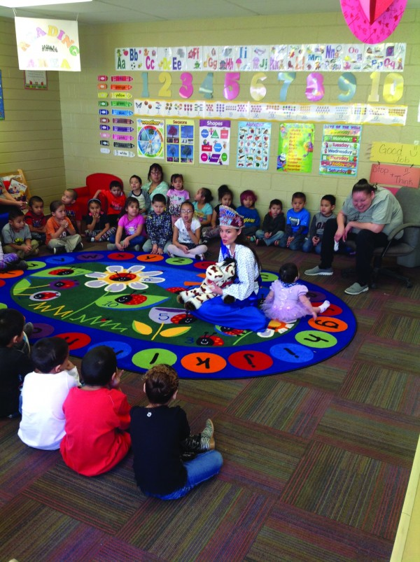 Miss Native American Kristina Hyatt (center), an EBCI tribal member, is shown visiting with students at the Pine Ridge Head Start Program in Pine Ridge, SD. (Photos courtesy of Miss Native American USA public relations)
