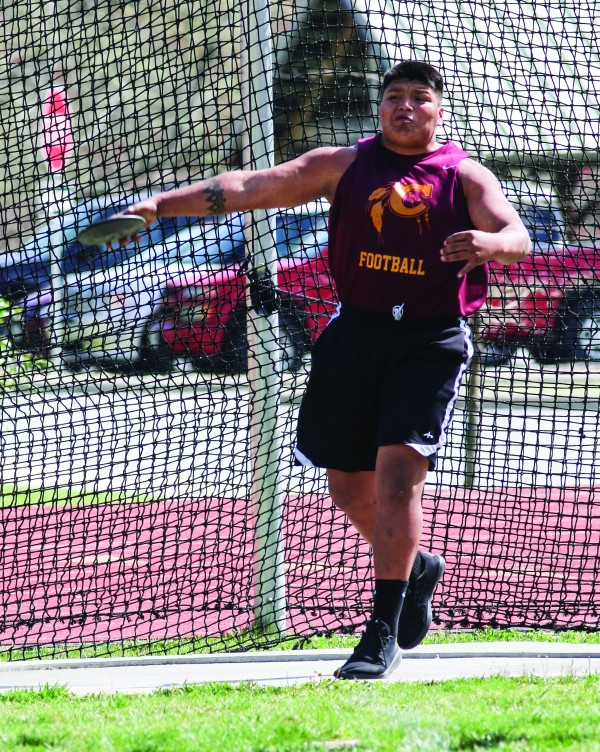 """Cherokee' Byron Locust wins the discus throw with a distance of 116' 4"""". He also won the shot put with a distance of 41' 8""""."""