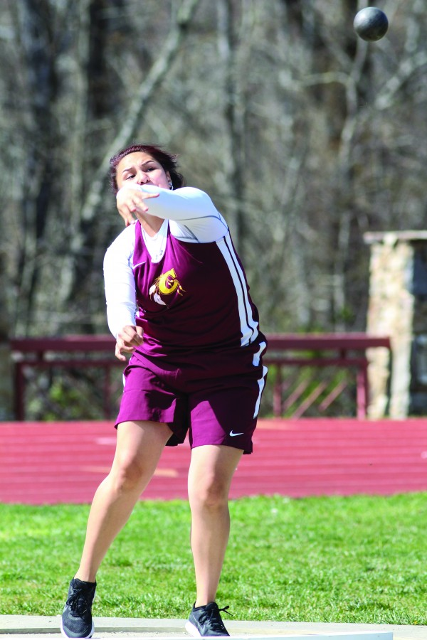 """Cherokee's Bree Jumper throws the shot put en route to a first place finish in the event with a distance of 28' 4"""". She also took first place in the discus throw with a distance of 88' 6""""."""