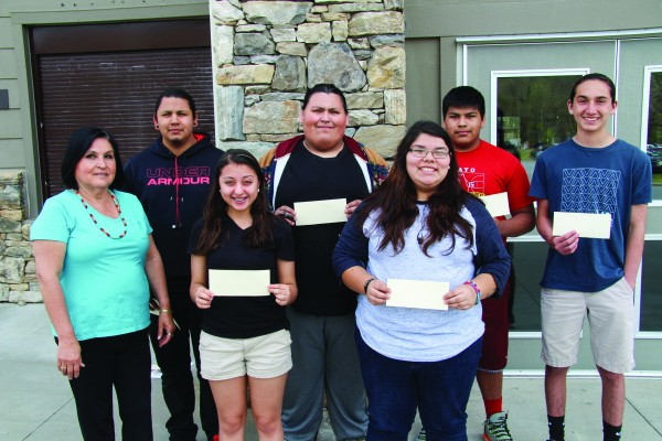 Several Cherokee High School students won awards and sold artwork at the recent  Heard Museum Guild American Indian Student Art Show.  They are shown (left-right) front row – Alyne Stamper, CHS art teacher; Kimmemelah Perkins; Laurel Welch; back row – Gabe Crow, Dylan West, Zakarias Perez and Fabian Crow.  Not pictured – Blake Wachacha.  (SCOTT MCKIE B.P./One Feather)