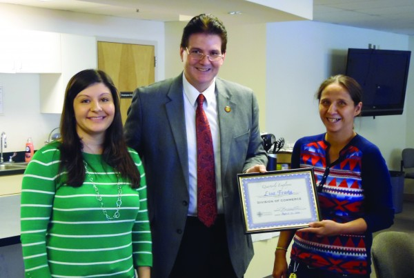 Lisa Frady (right), Cherokee Indian Fairgrounds events and group tour coordinator, receives the Commerce Division Employee of the Quarter Award from Tonya Carroll (left), Destination Marketing manager, and Dr. Mickey Duvall, EBCI Secretary of Commerce, during a recent Commerce Division quarterly meeting. (ROBERT JUMPER/One Feather photos)