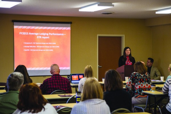 Tonya Carroll (standing in front), EBCI Destination Marketing manager, speaks during a tourism breakfast at the Fairfield Inn in Cherokee on Tuesday, April 19. (ROBERT JUMPER/One Feather)