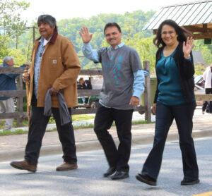 Cherokee speaker J.C. Wachacha leads out the Cherokee Speakers walk with Principal Chief Patrick Lambert (center) and Cyndi Lambert. (SCOTT MCKIE B.P./One Feather)