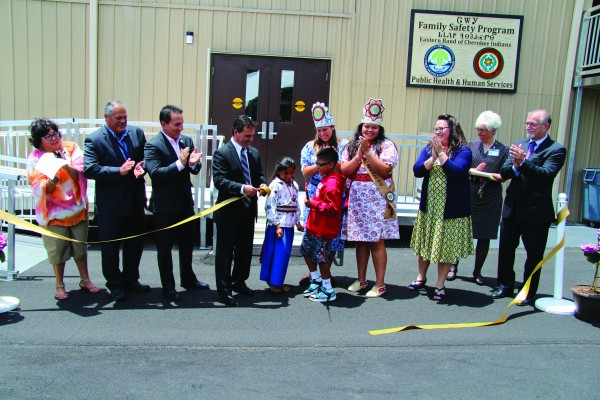 Eastern Band of Cherokee Indians tribal leaders celebrate the after cutting the ribbon to officially open the new Cherokee Family Safety Program Building on Tuesday, May 31. (SCOTT MCKIE B.P./One Feather photos)