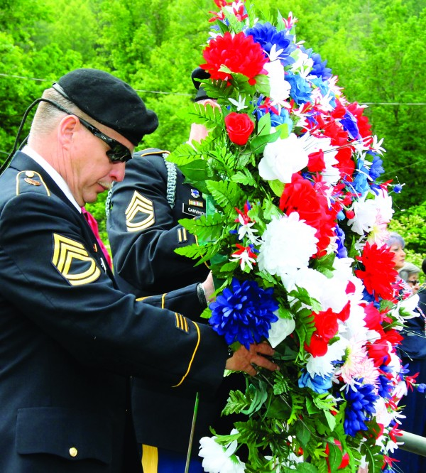 SFC Clifford Long and SFC  Alva Brown lay a wreath in honor and memory of EBCI tribal members that were killed in action in WWI, WWII, Korea, and Vietnam during last year's Memorial Day observance at the Yellowhill Veterans Cemetery. (SCOTT MCKIE B.P./One Feather)