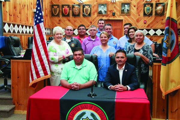 EBCI tribal leaders pose for a group shot following Tuesday's note signing.